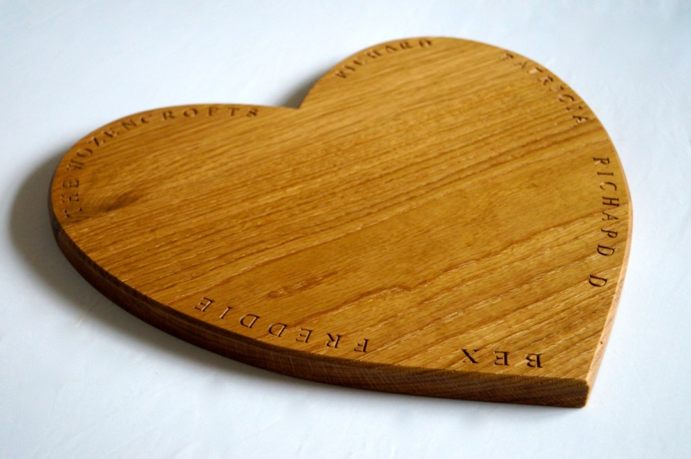 personalised engraved solid oak heart shaped chopping board